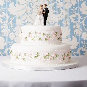 Wedding Cake with Bride and Groom Figurines --- Image by © Greg Hinsdale/Corbis